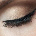 Closeup of beautiful woman eye with makeup, closed eyes